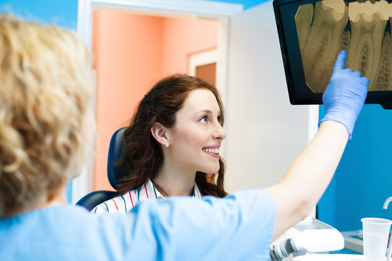 Doctor explaining digital x-ray to patient